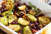 stock photo of vegan  - roasted brussels sprouts with grapes - JPG