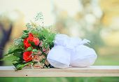 picture of booty  - Booties and rose bouquet close up outdoors - JPG