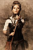 stock photo of post-apocalypse  - Portrait of a beautiful steampunk woman over grunge background - JPG