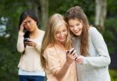 Teenage Girl Being Bullied By Text Message On Mobile Phone