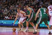 stock photo of unicity  - SAMARA RUSSIA - DECEMBER 02: Nikita Balashov of BC Krasnye Krylia with ball tries to go past a BC UNICS player on December 02 2012 in Samara Russia.