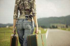 picture of runaway  - Young woman runaway walks away road - JPG