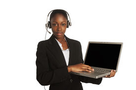 picture of dark-skin  - confident african business woman standing upwearing elegant clothes and headphones with the laptop - JPG