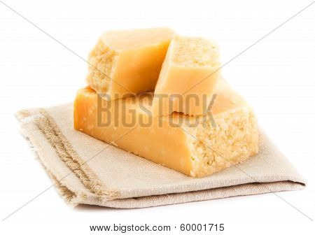 Parmesan Cheese  Isolated On White Background Close Up. Piece Of Parmesan Cheese On A Napkin, Studio