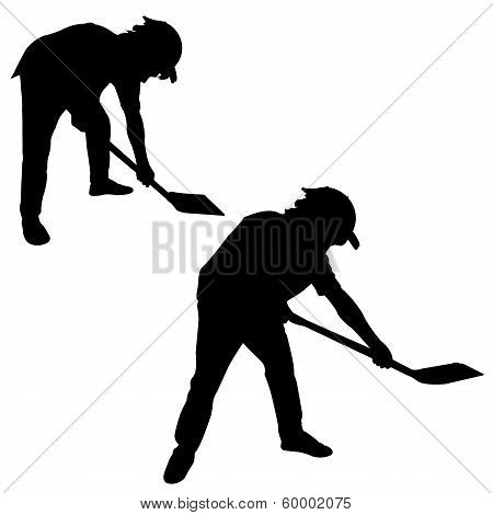 Silhouette Of Man With A Spade.eps
