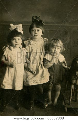 MOSCOW, USSR - CIRCA 1920: An antique photo shows studio portrait of a little sisters.
