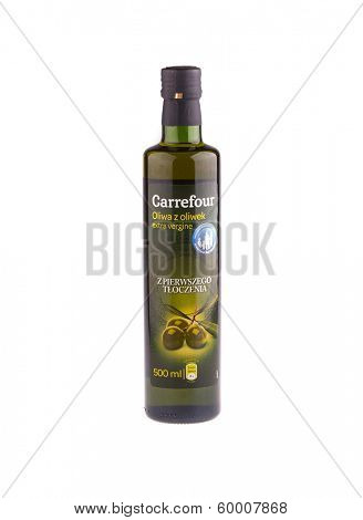KRAKOW, POLAND - FEB 8, 2014: Olive oil Carrefour isolated on white background. Carrefour SA, founded 1957 - French retailer, operator retail network, the second largest in the world after Wal-Mart.