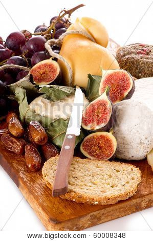 cheeseboard  with an assortment of cheeses  and fruits
