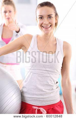 Beautiful girl training with ball