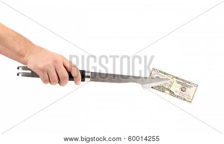 Hand holding of BBQ tongs with fifty dollars bill