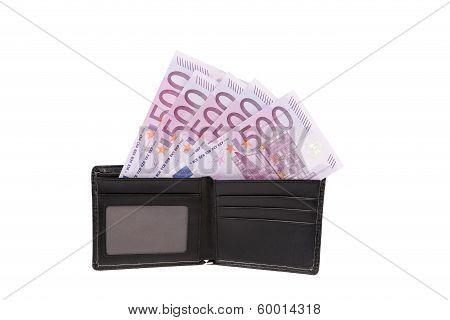 Five hundred euro bill in open wallet.