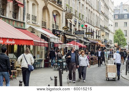 Tourists Walk Past A Cafeteria And Souvenir Store - Paris, France.