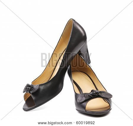 Pair of black woman shoes.