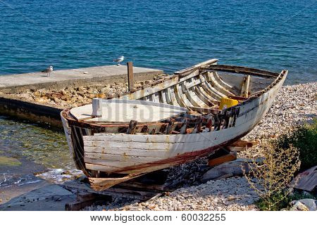 Old Wooden Boat Broken By The Sea