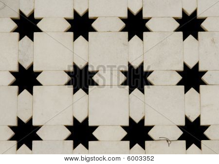 White Marble Wall With Star Shape Cut-outs. Jaigurudeo Temple, India