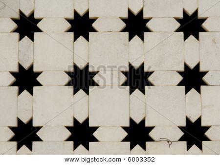 Pared de mármol blanca con forma de estrella cortes. Templo de Jaigurudeo, India