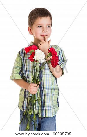 thoughtful boy with carnations
