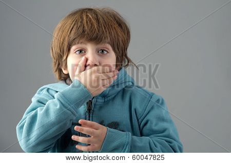 young beautiful kid with a shocking expression