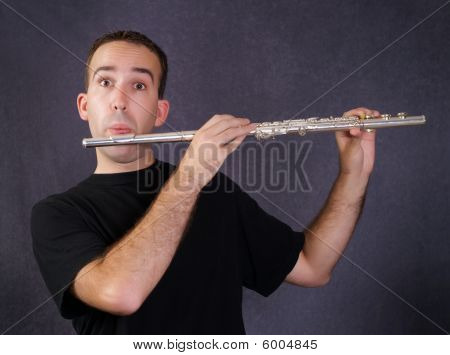 Man Playing Flute
