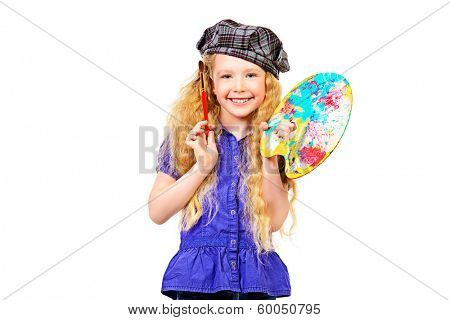 Pretty little girl painter posing with a brush and palette. Isolated over white.