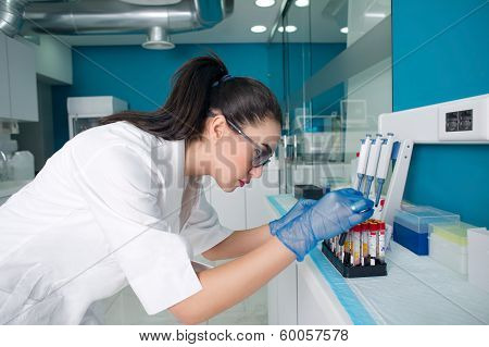 Female doctor diagnosing a blood test in lab