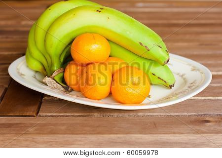 Banana And Orange On Slat