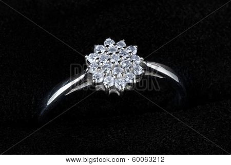 White gold ring with diamonds isolated on black, macro