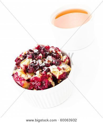 Fresh Blueberry Crumble Dessert In A Bowl With A Cup Of Tea  On White Background