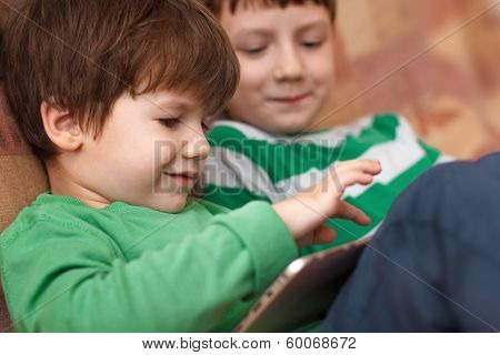 Little Kids Playing On Tablet