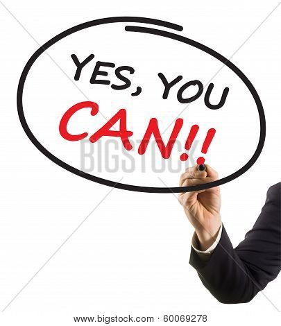 businessman hand with felt tip marker writing text yes you can