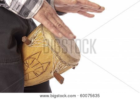 Man Playing African Drum Between Legs