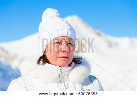Woman In Ski Suit On A Background Of Mountains