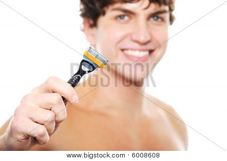 Happy Clean-shaven Face Of A Young Man With Razor In The Hand
