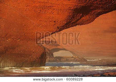 Legzira dramatic natural stone arches reaching over the sea, Atlantic Ocean, Morocco, Africa