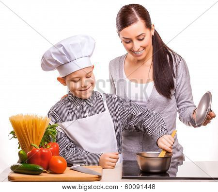 mom and son are cooking in the kitchen
