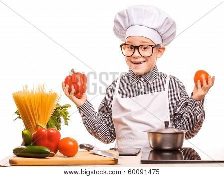 boy chef is cooking in the kitchen