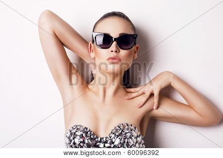 sexy woman in luxurious corset and sunglasses