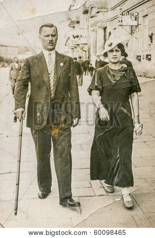 LUBLIN, POLAND, MAY 15, 1939 - vintage photo of happy couple  walking on street