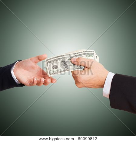 Businessman giving money cash dollars in the hands