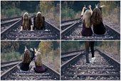 image of runaway  - Two girls sitting on railway tracks and show love horizontal - JPG