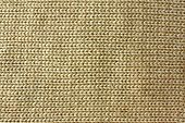 image of tan lines  - a background of tweed tan or camel colored knit fabric is braided in lines - JPG