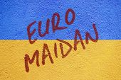 Постер, плакат: Ukraine Flag Painted On Old Concrete Wall With Euro Maidan Inscription