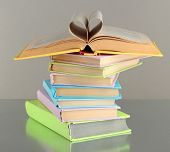 foto of short-story  - Stack of books on grey background - JPG