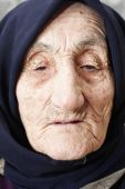 Old Woman Lost In Thoughts