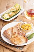 pic of pork cutlet  - Pork cutlets on a bone with apple and raisin chutney and grilled zucchini
