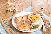 image of pork cutlet  - Pork cutlets on a bone with apple and raisin chutney