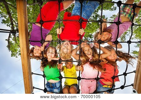 Many kids look though gridlines of playground