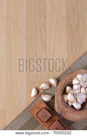 garlics in coconut shell on wooden background