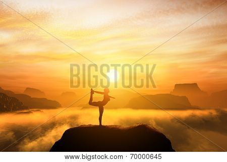 Woman meditating in the dancer yoga position on the top of a mountains above clouds at sunset. Zen, meditation, peace