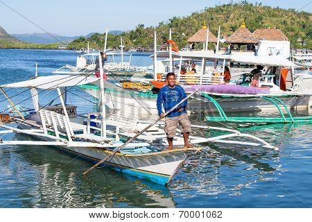 Tourists Travel By Boat Between The Islands Of The Philippines